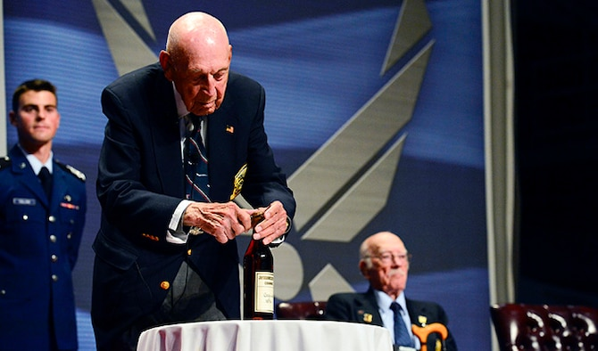 "Retired Lt. Col. Richard ""Dick"" E. Cole opens the 1896 bottle of cognac before The Doolittle Tokyo Raiders shared their last and final toast at the National Museum of the U.S. Air Force Nov. 09, 2013 in Dayton, Ohio. Cole was the copilot of Aircraft No. 1."