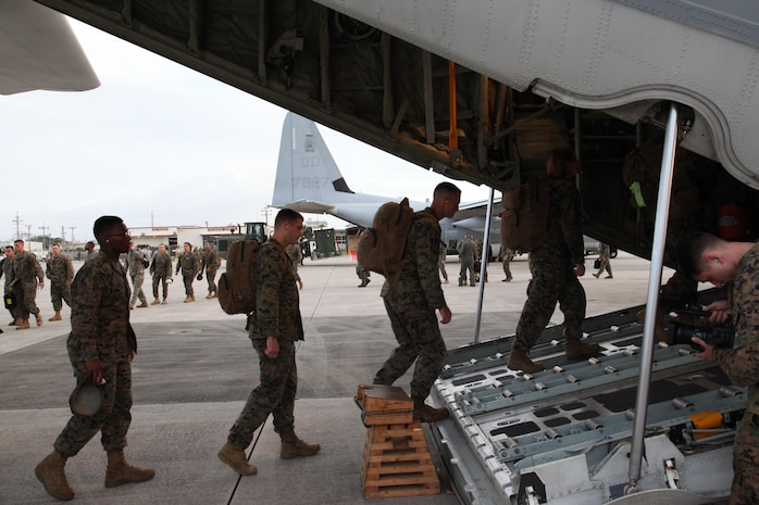 Marines board a KC-130J Hercules aircraft Nov. 10 at Marine Corps Air Station Futenma, Okinawa, Japan, moments before departing for a humanitarian assistance and disaster relief mission to the Philippines. Typhoon Haiyan has impacted more than 4.2 million people across 36 provinces in the Philippines, according to the Philippine government's national disaster risk reduction and management council. Since 1990, the U.S. Government has responded to more than 40 disasters in the Philippines at the request of that country's government, ranging from volcanic eruptions, drought, and population displacement. MCAS Futenma is a mission ready air station capable of continuous aviation and base operating support for tenant organizations and follow-on U.S., Allied, and United Nations forces during combat or contingency operations in the Western Pacific Theater of operations, to include U.S. Pacific Command, Marine Corps Forces Pacific and Marine Corps Installations Pacific.