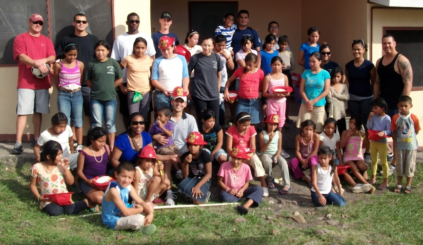 Twenty-one members of the 612 ABS spent the afternoon at the Nuestra Senora de Guadalupe orphanage in Comayagua, Honduras, Sept. 6, 2013.  Six children at the orphanage had a birthday during the month of November, and the 612 ABS members brought along birthday gifts to celebrate the occassion.  Members of the 612th spent the afternoon playing and visiting with the children.  (U.S. Air Force photo by Tech. Sgt. Stacy Rogers)