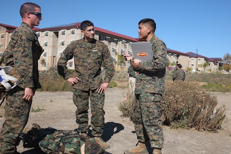 Petty Officer 2nd Class Peter Lam, right, a Navy tactical readiness training instructor with Combat Logistics Regiment 17, 1st Marine Logistics Group, teaches lifesaving scenarios during a combat lifesaver course aboard Camp Pendleton, Calif., Nov. 6, 2013. During the course, Marines and sailors learned vital techniques such as providing CPR, treating injuries like sucking chest wounds and applying tourniquets.