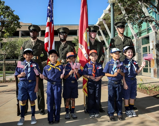 Members of the Anaheim Cub Scout Pack #546 pose for pictures with the 15th Marine Expeditionary Unit color guard during a Veterans Day ceremony outside City Hall in Anaheim, Calif., Nov. 9. Lieutenant Col. John R. O'Neal, commanding officer, 15th MEU, served as the keynote speaker during the ceremony, which included addresses by local leaders and a cake cutting celebration in honor of the Marine Corps' 238th birthday. (U.S. Marine Corps Photo by Cpl. Emmanuel Ramos/Released)