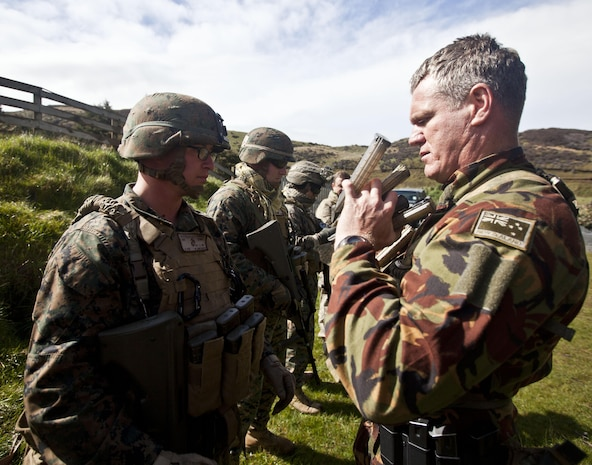 New Zealand Defence Force Sgt. Geoff Brown, personal protection officer, Military Police, inspects members of a personal protection team prior to a familiarization shooting range with the Individual Weapon (IW) Steyr assault rifle during the initial stages of exercise Southern Katipo 2013 at Waiouru Military Camp, New Zealand, Nov. 7. SK13 strengthens military to military relationships and cooperation with partner nations and the NZDF. Brown is from Wellington, New Zealand.