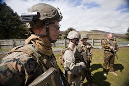 Cpl. Thomas Cornwall, military policeman with 1st Law Enforcement Battalion, from Ventura, Calif., and other members of a personal protection team receive a safety brief prior to a familiarization shooting range with the Individual Weapon (IW) Steyr assault rifle during the initial stages of exercise Southern Katipo 2013 at Waiouru Military Camp, New Zealand, Nov. 7. SK13 increases the ability of all participants to coordinate in complex situations.