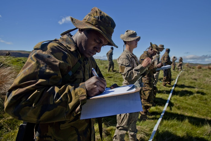 Papua New Guinean engineers from Engineer Battalion and sappers with 2 Field Squadron Royal Engineers based out of Linton Military Camp, New Zealand, identify improvised explosive devices at combat hunter training during the initial stages of exercise Southern Katipo 2013 aboard Waiouru Military Camp, New Zealand, Nov. 9. SK13 is designed to improve participating forces' combat training, readiness and interoperability as part of a Joint Inter-Agency Task Force.