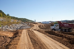 The U.S. Army Corps of Engineers Nashville District grades near the west tie in with the existing Bear Creek Road at the Y-12 National Security Complex in Oak Ridge, Tenn., Oct. 9, 2013. AVISCO is a women-owned small business that has the contract for this project.