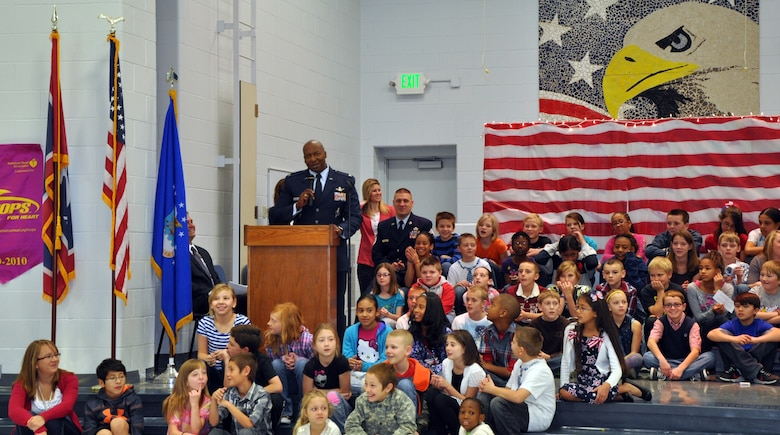 131111-F-CP692-005 Col. Carl Jones, 90th Missile Wing vice commander, talks to children and parents during a Veterans Day Ceremony at Freedom Elementary School Nov. 11. Jones spoke on the importance of military families to Airman and how they serve their country as much as the Airmen. (U.S. Air Force photo by 1st Lt. Eydie Sakura)