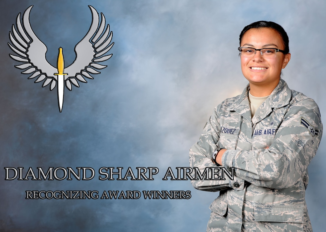 Airman 1st Class Samantha Velazquez, 27th Special Operations Aerospace Medicine Squadron public health apprentice, poses after receiving the Diamond Sharp award at Cannon Air Force Base, N.M. Velazquez was recently recognized as a Diamond Sharp Award winner for the month of November and was highlighted for her hard work and achievements. (U.S. Air Force photo/Senior Airman Ericka Engblom)