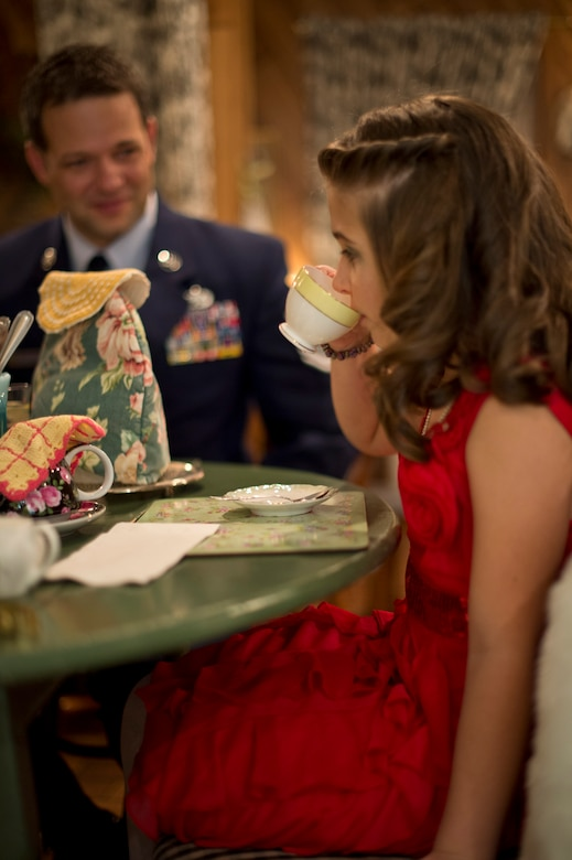 Master Sgt. Jason Thompson of the 133rd Airlift Wing makes time for 'teatime' with his daughter, Ellie, at the Avalon Tearoom & Pastry Shoppe in White Bear Lake, Minn. on Nov. 8.  (U.S. Air National Guard photo by Tech. Sgt. Lynette Olivares/Released)