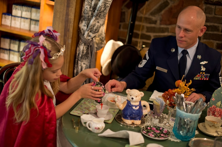 'Princess' Annalise has a real life 'teatime' with her Dad, Senior Master Sgt. Greg Wolhfeil, at the Avalon Tearoom & Pastry Shoppe in White Bear Lake, Minn. on Nov. 8.  Wolhfeil, member of the 133rd Airlift Wing, wore his Air Force Blues and suggested his daughter 'dress up' as a way to show them how much she is appreciated.   (U.S. Air National Guard photo by Tech. Sgt. Lynette Olivares/Released)