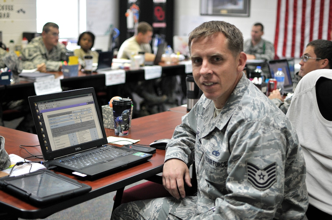 MCGHEE TYSON AIR NATIONAL GUARD BASE, Tenn. - Tech. Sgt. Drew Carson sits with C-Flight of the U. S. Air Force's Noncommissioned Officer Academy 14-1 here Nov. 12, 2013, at the I.G. Brown Training and Education Center while he observes and evaluates another instructor. Carson is an active duty enlisted professional military education instructor with the Paul H. Lankford EPME Center. He said he likes coming to work each day.  (U.S. Air National Guard photo by Master Sgt. Mike R. Smith/Released)