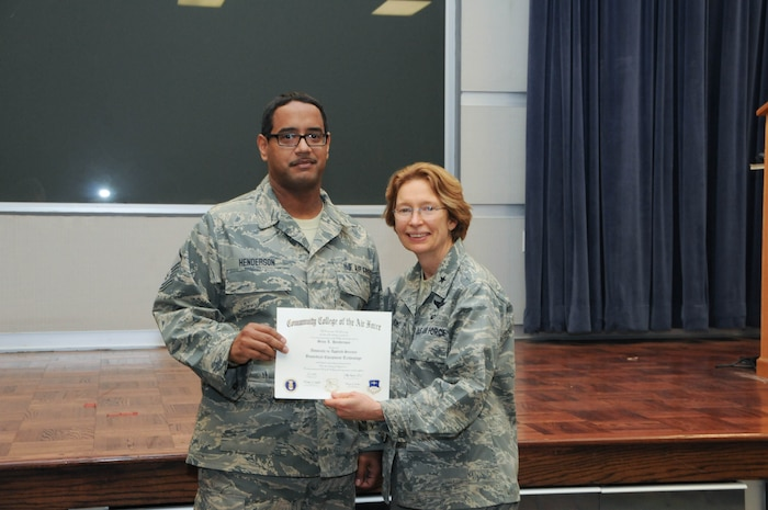 U.S. Air Force Master Sgt. Sean Henderson, left, a member of the 166th Medical Group, 166th Airlift Wing, receives a certificate from Brig. Gen. Carol Timmons, assistant adjutant general for air, Delaware National Guard to recognize Henderson's attainment of a Community College of the Air Force associate of applied science degree in biomedical equipment technology at a CCAF Class of October 2013 graduation ceremony held Nov. 3, 2013 at the New Castle Air National Guard Base, Del. (U.S. Air National Guard photo by Tech. Sgt. Robin Meredith)