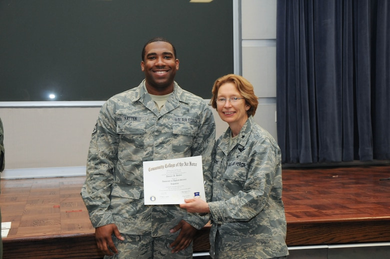 U.S. Air Force Staff Sgt. Jomarr Hatten, left, a member of the 166th Logistics Readiness Squadron, 166th Airlift Wing, receives a certificate from Brig. Gen. Carol Timmons, assistant adjutant general for air, Delaware National Guard to recognize Hatten's attainment of a Community College of the Air Force associate of applied science degree in logistics a CCAF Class of October 2013 graduation ceremony held Nov. 3, 2013 at the New Castle Air National Guard Base, Del. (U.S. Air National Guard photo by Tech. Sgt. Robin Meredith)