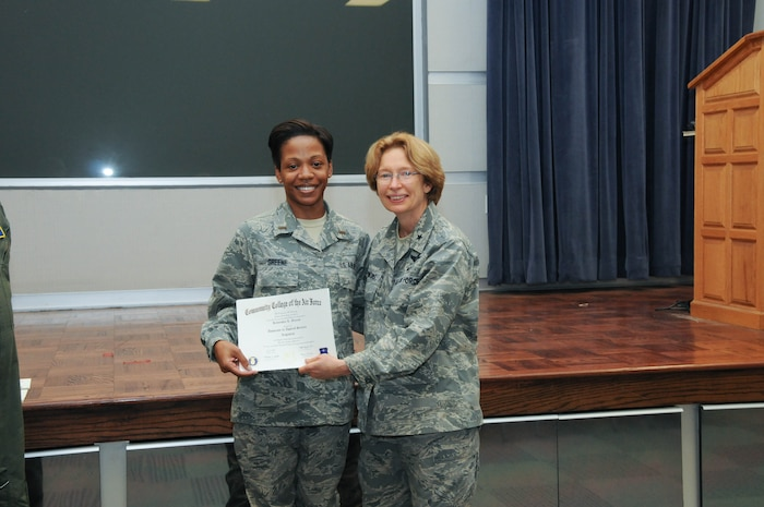 U.S. Air Force Master Sgt. (now 1st Lt.) Kemeshia Greene, left, a member of the 142nd Airlift Squadron, 166th Airlift Wing, receives a certificate from Brig. Gen. Carol Timmons, assistant adjutant general for air, Delaware National Guard to recognize Greene's attainment of a Community College of the Air Force associate of applied science degree in logistics a CCAF Class of October 2013 graduation ceremony held Nov. 3, 2013 at the New Castle Air National Guard Base, Del. (U.S. Air National Guard photo by Tech. Sgt. Robin Meredith)
