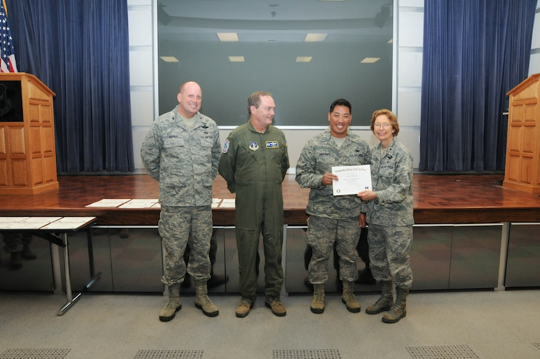 U.S. Air Force Staff Sgt. Richard Bergante, second from right, a member of the 166th Security Forces Squadron, 166th Airlift Wing, receives a certificate from Brig. Gen. Carol Timmons, assistant adjutant general for air, Delaware National Guard to recognize Bergante's attainment of a Community College of the Air Force associate of applied science degree in criminal justice at a CCAF Class of October 2013 graduation ceremony held Nov. 3, 2013 at the New Castle Air National Guard Base, Del. 166th AW Commander Col. Mike Feeley, second from left, is next to 166th AW Vice-Commander Col. Dave Byerly, left. (U.S. Air National Guard photo by Tech. Sgt. Robin Meredith)
