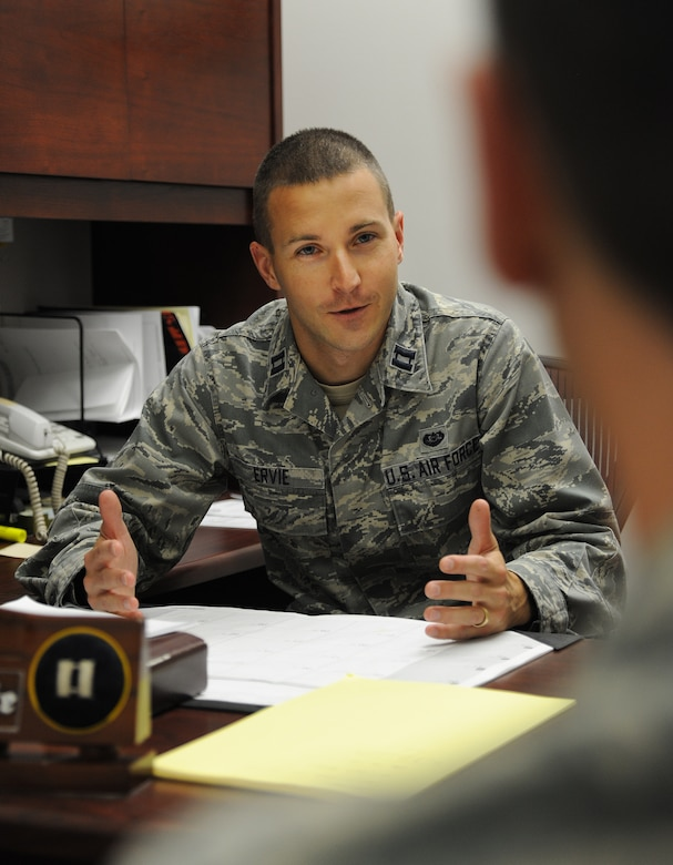 U.S. Air Force Capt. Phillip Ervie, 509th Bomb Wing Judge Advocate chief of adverse actions, provides legal assistance to an Airman at Whiteman Air Force Base, Mo., Oct. 30, 2013. The military justice system is designed to promote good order and discipline and to ensure mission accomplishment. (U.S. Air Force photo by Staff Sgt. Nick Wilson/Released)