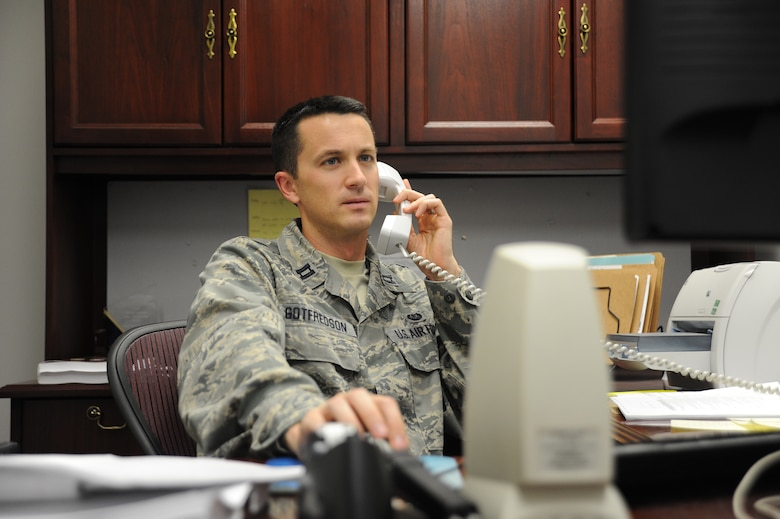 U.S. Air Force Capt. Kevin Gotfredson, 509th Bomb Wing Judge Advocate chief of military justice, advises a first sergeant on a disciplinary issue at Whiteman Air Force Base, Mo., Oct. 30, 2013. The legal office provides a variety of services in order to meet the legal needs of all active-duty, Guard and Reserve military members, civilians, dependents and retirees at Team Whiteman. (U.S. Air Force photo by Staff Sgt. Nick Wilson/Released)