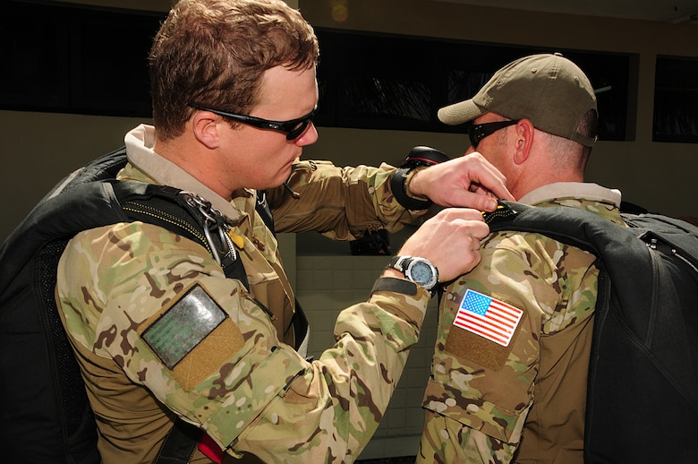 U.S. Air Force Capt. Kyle, 131st Rescue Squadron combat rescue officer, performs a buddy check on Master Sgt. Kyle, 131st Rescue Squadron pararescueman, prior to boarding a Brazilian Air force C-130E Hercules at Natal Air Base, Natal, Brazil, Nov. 7, 2013. The two will be training with Brazilian and Canadian pararescuemen throughout CRUZEX, a Brazilian-led led exercise focused on interoperability between participating Air Forces. (U.S. Air Force photo by Senior Airman Camilla Elizeu/Released)