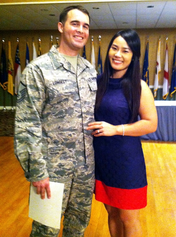 Master Sgt. Jacob Longest poses with his wife Seonkyoung Longest at an enlisted promotions ceremony April 30, 2013, Columbus Air Force Base, Miss. Jacob is the 14th Medical Operations Squadron interim superintendent. (Courtesy Photo)