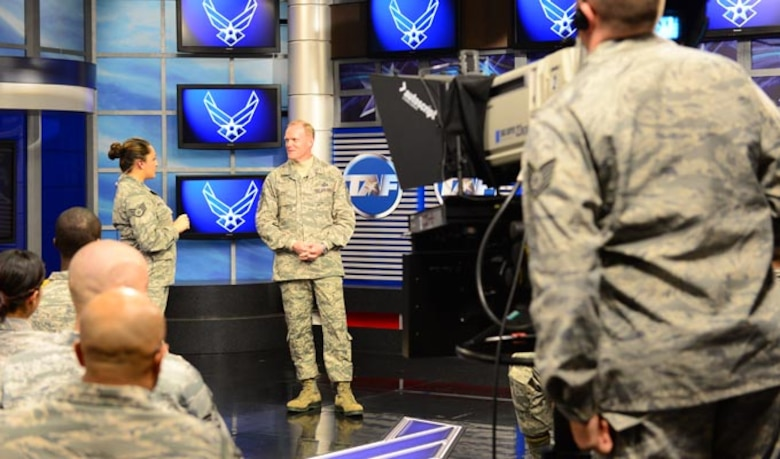 """Chief Master Sgt. of the Air Force James Cody (center) is interviewed by Staff. Sgt. Shaun Hostutler (left) during a taping of """"CHIEFChat"""" Nov. 12, 2013, at the Defense Media Activity at Fort George G. Meade, Md. Cody answered questions from live audience members as well as from Air Force social media channels and prerecorded video questions from Airmen. Cody discussed issues ranging from promotion testing to sexual assault prevention."""