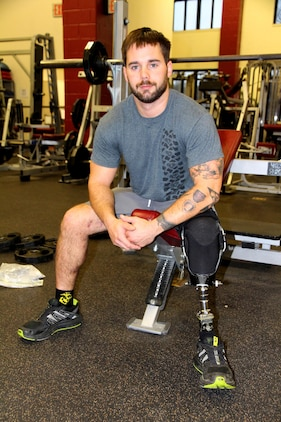 John Patterson, a wounded warrior and medically retired Marine, was injured when a bomb went off as he entered a building during a combat patrol Jan. 23, 2011. The blast severed his left leg below the knee. Patterson, a native of Columbia, Md., now works as an intern at Program Executive Officer Land Systems through the Wounded Warrior Intern Program, part of the Naval Acquisition Development Program.