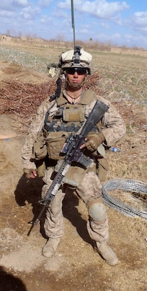 Lance Cpl. John Patterson, a native of Columbia, Md., took this photo during his deployment to Helmand Province, Afghanistan in 2011. Patterson's left leg was severed below the knee when a bomb went off as he entered a building during a combat patrol Jan. 23, 2011. He now works as an intern at Program Executive Officer Land Systems through the Wounded Warrior Intern Program, part of the Naval Acquisition Development Program.