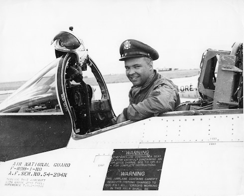 "Walter W. ""Wally"" Fellman, Jr., smiles as he sits in the cockpit of an OreANG Northrop F-89H Scorpion fighter-interceptor in the late 1950s.  Fellman flew the North American F-86 Sabre fighter in combat during the Korean War."