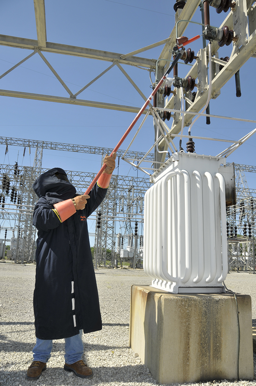 Tom Dimon, ATA Electrician, Performs High Voltage Maintenance. He Is  Wearing An Array ? Amazing Design