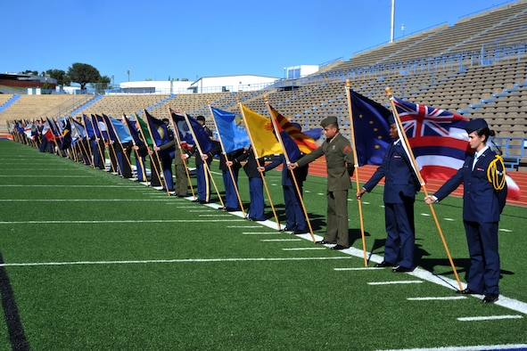 SAN ANGELO, Texas-- Volunteers from Goodfellow Air Force Base hold state flags at the Angelo State University Military Appreciation Day football game Nov. 9 at the LeGrand Stadium. All military personnel and family were invited by ASU to attend the Military Appreciation Day on ASU campus and at the football stadium. (U.S. Air Force photo/ Senior Airman Michael Smith)