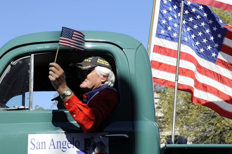 SAN ANGELO, Texas – An American veteran waves a flag as he drives his vehicle during the Veteran's Day Parade Nov. 9 in historic downtown San Angelo. Volunteers from all over the San Angelo community volunteered to participate in the parade. (U.S. Air Force photo/ Staff Sgt. Austin Knox)