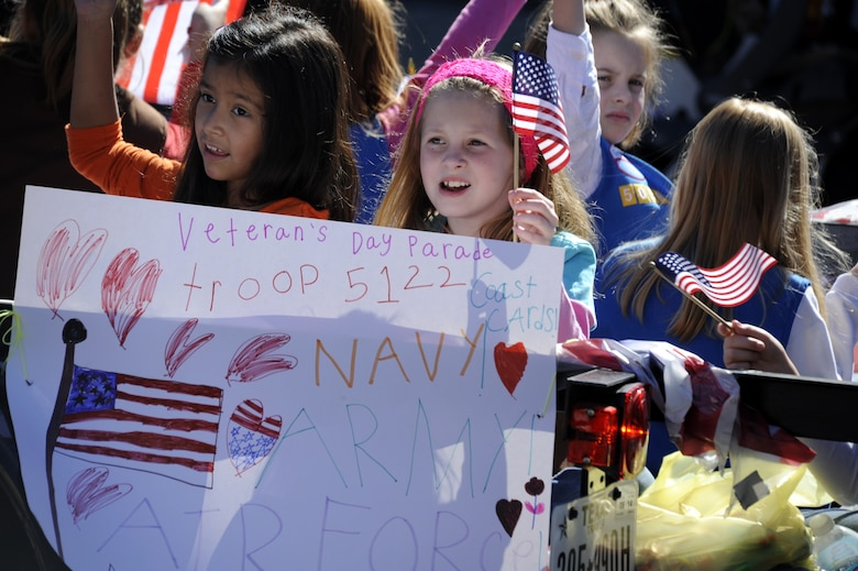 SAN ANGELO, Texas – Children from San Angelo cheer during the Veteran's Day Parade Nov. 9 in historic downtown San Angelo. Team Goodfellow and the San Angelo community came together to march, walk, and cheer in celebration of America's veterans. (U.S. Air Force photo/ Staff Sgt. Austin Knox)