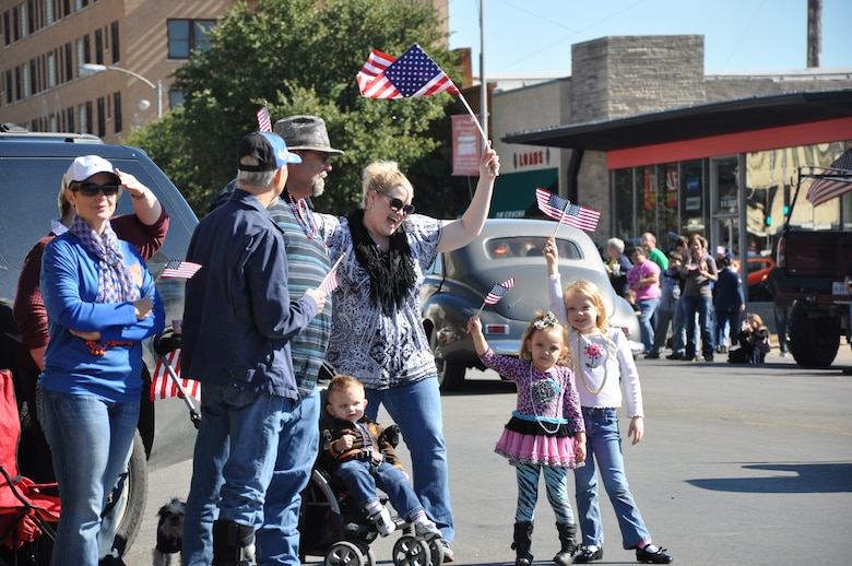 SAN ANGELO, Texas — San Angelo community members cheer as the parade goes by during the Veteran's Day Parade Nov. 9 in historic downtown San Angelo. The San Angelo community and Team Goodfellow hosted the parade to honor veterans for their service and sacrifice to the country. (U.S. Air Force photo/ Airman 1st Class Breonna Veal)