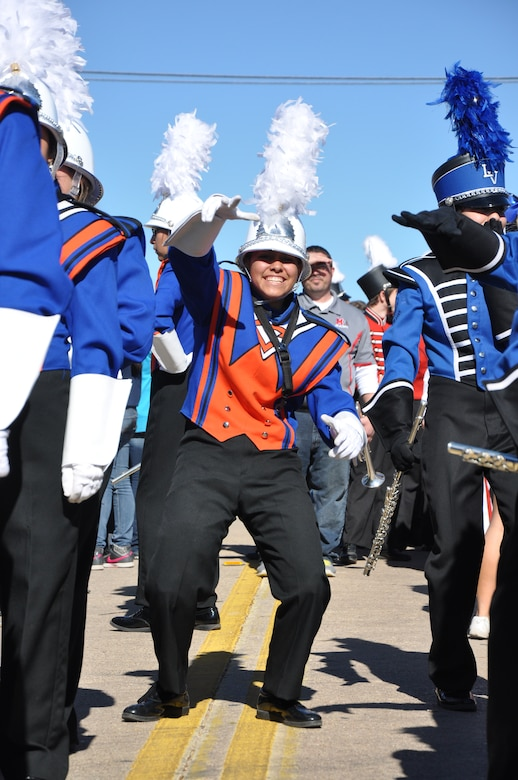 SAN ANGELO, Texas — A member from the Central High School marching band dances as the drum line plays before the Veteran's Day Parade Nov. 9 in historic downtown San Angelo. Over 500 members from Goodfellow Air Force Base volunteered to march in the parade to show support. (U.S. Air Force photo/ Airman 1st Class Breonna Veal)