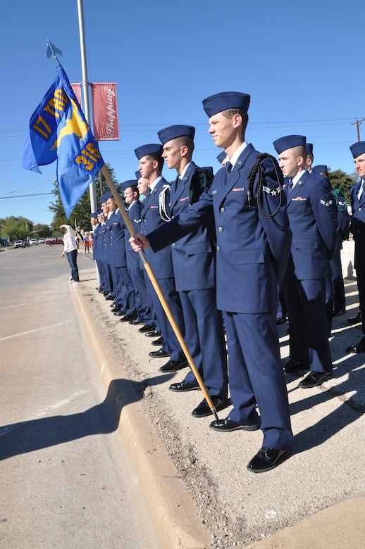 SAN ANGELO, Texas— Airman 1st Class Matthew Karnes, 316th Training Squadron student and guidon bearer, stands with the rest of his flight before the Veteran's Day Parade Nov. 9 in historic downtown San Angelo. Karnes volunteered for Veteran's Day Parades for the last six years.  (U.S. Air Force photo/ Airman 1st Class Breonna Veal)