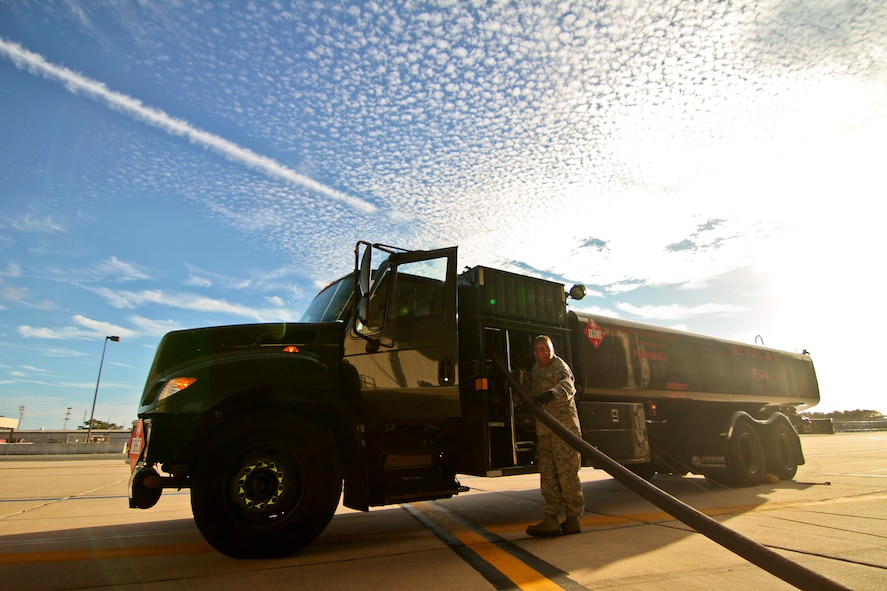 U.S. Air Force Tech. Sgt. Kevin Dickinson keeps watch at his R-11 refueling truck as he refuels an F-16C Fighting Falcon from the New Jersey Air National Guard's 177th Fighter Wing at Atlantic City Air National Guard Base, N.J. on Nov. 6.  Dickinson is a fuels specialist assigned to the 177th Logistics Readiness Squadron.  (U.S. Air National Guard photo by Tech. Sgt. Matt Hecht/Released)