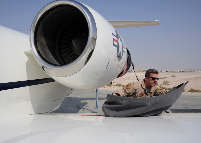 1st Lt. Geoff Howard removes a dust cover from the engine of a C-21 Firebass at the 379th Air Expeditionary Wing in Southwest Asia, Nov. 5, 2013. Distinguished visitor transport is a key resource in a deployed location as it enables decision makers to have face-to-face contact while building partnerships. Howard is a 379th Expeditionary Operation Group C-21 pilot deployed from Joint Base Andrews, Md., and hails from San Antonio, Texas. (U.S. Air Force photo/Senior Airman Bahja J. Jones)