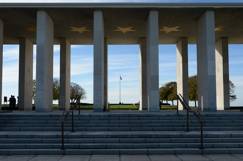 HOMBOURG, Belgium --- A promenade adorned with 13 golden stars and pillars representing the American states and territories stands at the Henri-Chapelle American Cemetery Nov. 11, 2013. The walls of the promenade are lined with the names of more than 400 American service members who are listed as missing while serving in World War II. (U.S. Air Force photo by Staff Sgt. Joe W. McFadden/Released)