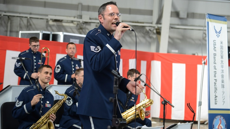 Staff Sgt. Geoff Fisher, Band of the Pacific-Asia vocalist, sings during the opening ceremony of the Iruma Air Show at Iruma Air Base, Japan, Nov. 3, 2013.  The band performed songs in both English and Japanese to entertain the attendants.  (U.S. Air Force photo by Airman 1st Class Soo C. Kim / Released)