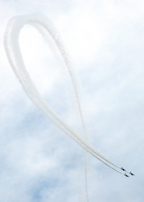 The Japan Air Self-Defense Force aerobatic team, Blue Impulse, draws a large ribbon in the sky during the annual Iruma Air Show at Iruma Air Base, Japan, Nov. 3, 2013. Blue Impulse performed many maneuvers during the show. (U.S. Air Force photo by Airman 1st Class Soo C. Kim / Released)