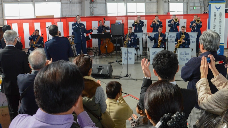 A crowd cheers as the Pacific Air Forces Band finishes their performance at Iruma Air Base, Japan, Nov. 3, 2013. The PACAF Band were one of many Yokota members invited to the annual Iruma Air Show.  (U.S. Air Force photo by Airman 1st Class Soo C. Kim / Released)