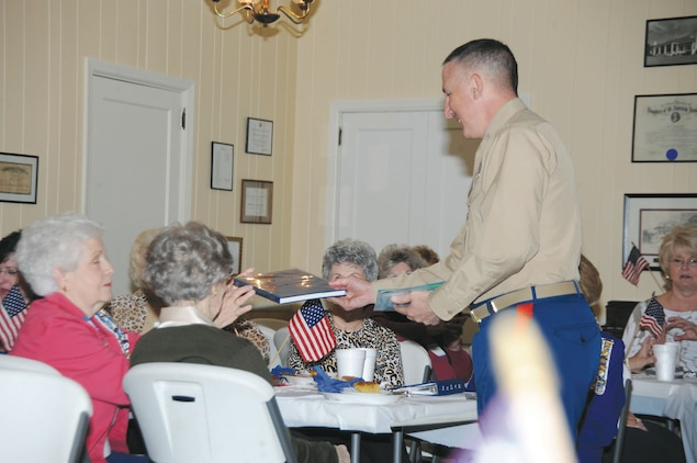 Col. Don Davis, commanding officer, Marine Corps Logistics Base Albany, speaks to members of the local Daughters of the American Revolution Chapter in honor of Veterans Day, Nov. 7.