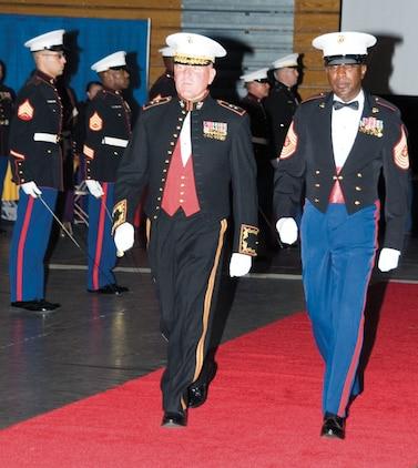Maj. Gen. John J. Broadmeadow, commanding general, Marine Corps Logistics Command, left, escortss retired Sgt. Maj. Carlton Kent, 16th sergeant major of the Marine Corps, during the 238th Marine Corps Birthday Ball celebration, Friday at Albany State University.