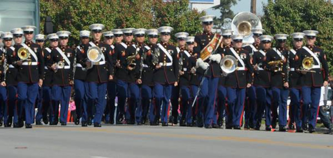 The 2nd Marine Division Band leads the 18th annual Jacksonville Veterans Parade, Nov. 9.  Thousands of community members lined the streets to honor and support past and present service members.