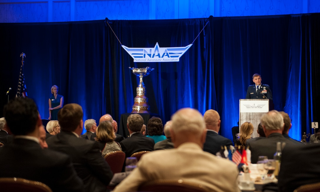 """Air Force Assistant Vice Chief of Staff Lt. Gen. Stephen Hoog, gives remarks during the Mackay Trophy presentation, at Arlington, Va., Nov. 12, 2013. The trophy is awarded for the """"most meritorious flight of the year"""" by an Air Force person, persons, or organization. (U.S. Air Force photo/Staff Sgt. Carlin Leslie)"""