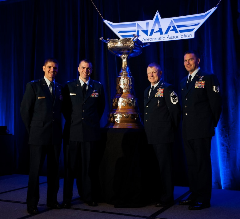 "Members of Pedro 83 Flight, from left, Capt. Vincent Powell, Capt. Brion Stroud, Chief Master Sgt. Norman Callahan and Tech. Sgt. John Ballard, accept the Mackay Trophy on behalf of Pedro 83 Flight during a ceremony, in Arlington, Va., Nov. 12, 2013. The trophy is awarded for the ""most meritorious flight of the year"" by an Air Force person, persons or organization.(U.S. Air Force photo/Staff Sgt. Carlin Leslie)"