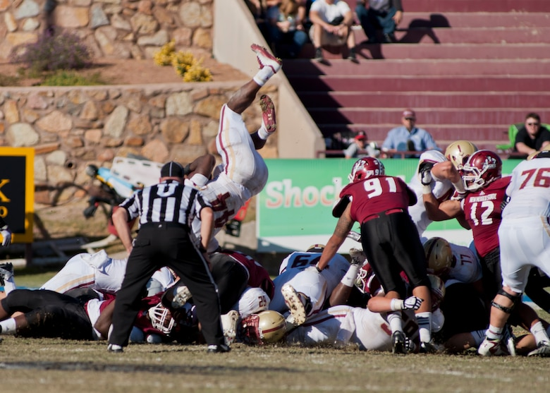 The New Mexico State University football team squares off against Boston College during their annual military appreciation game, which honored current and past military veterans at Aggie Memorial Stadium in Las Cruces, N.M., Nov. 9. The NMSU athletic director presented several awards to military members who attended the game. (U.S. Air Force photo by Airman 1st Class Aaron Montoya/Released)