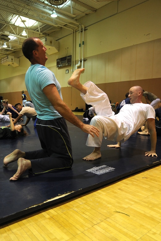 Adam Fruge, 341st Logistics Readiness Squadron hazardous materials supervisor (left), and Master Sgt. Robert Carroll, 490th Missile Squadron member, practice a self-defense scenario during a Gracie Academy Women Empowered self-defense seminar. Malmstrom Air Force Base is the third military installation to receive weeklong seminars based on Gracie Jiu-Jitsu techniques. (U.S. Air Force photo/Senior Airman Katrina Heikkinen