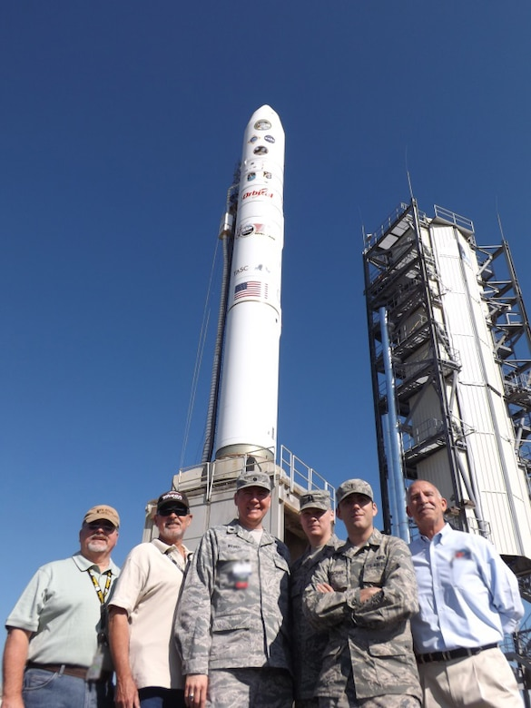 The U.S. Air Force's Launch Systems Division Launch Operations Team stand beside the Orbital Sciences Minotaur V.  From left to right are Mr. Keith Witt (AeroThermo Technology Inc.); Mr. John Wee (TASC); Lt. Col. Jeff Wiemeri, SDL Chief of Launch Operations;  Capt. Mike Moen, SDL Minotaur V Mission Manager; 1st Lt. Justin Oryschak, SDL Deputy Mission Manager and Mr. Paul Carman (TASC). (US Air Force photo)