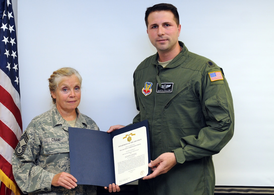 Chief Master Sgt. Cindy Crane (Left) receives The Air Force Commedation Medal from Lt. Col. Martin Stallone, Commander of the 174th Medical Group on 2 Nov 2013 during a ceremony held at Hancock Field Air National Guard Base, Syracuse, New York. (New York Air National Guard Photo by Senior Airman Duane Morgan)