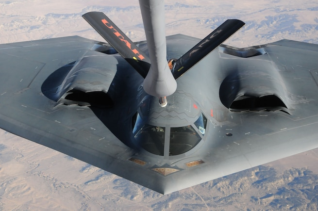 The Spirit of Pennsylvania, a B-2 Spirit bomber, is refueled inflight by a KC-135 Stratotanker from the Utah Air National Guard in Salt Lake City, on November 3, 2013, somewhere over Colorado.