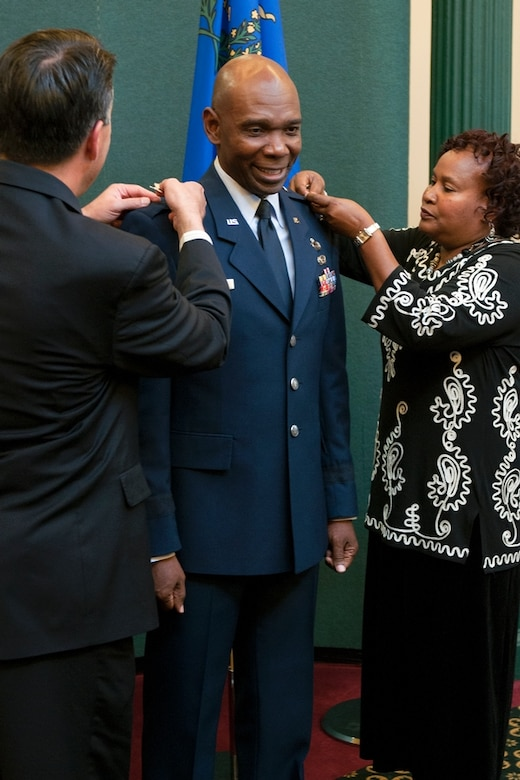 Ondra Berry, center, receives his stars marking his promotion to brigadier general from Gov. Brian Sandoval and his wife Margo Berry during a ceremony in the Guinn Room at the Nevada Capitol on Nov.12. Berry is the first African-American general in the Nevada Guard and is now the Nevada Air Guard's assistant adjutant general.